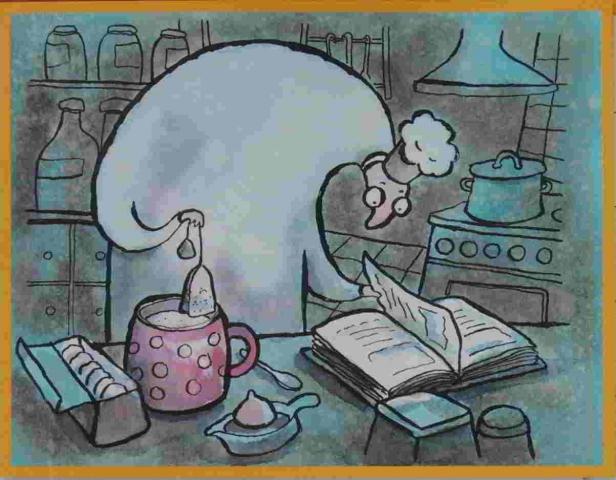 kuchař podobný čaroději čte v kuchařce a vaří